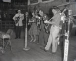 Bill Carlisle and the Carlisles performing on the Grand Ole Opry